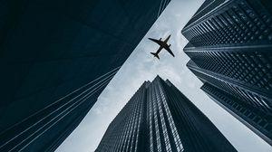 Preview wallpaper airplane, buildings, skyscrapers, sky