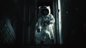 Preview wallpaper astronaut, cosmonaut, gravity, spacesuit, door, dark
