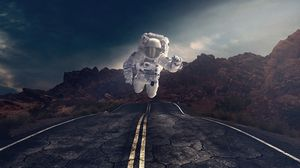 Preview wallpaper astronaut, gravity, road, asphalt, rocks, stones