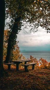 Preview wallpaper autumn, benches, table, sea, shore, trees, foliage