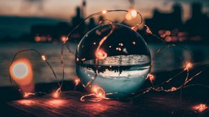 Preview wallpaper ball, garland, glass, transparent, sunset