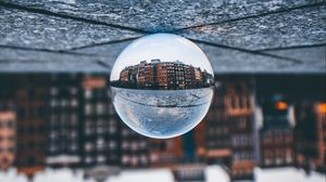Preview wallpaper ball, glass, reflection, building, blur