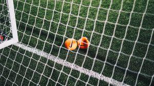 Preview wallpaper balls, football, netting, gate, football field