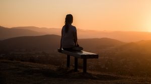 Preview wallpaper bench, alone, solitude, sunset, mountains, girl