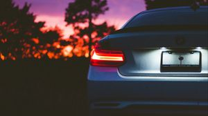 Preview wallpaper bmw, rear view, headlight, sunset, light