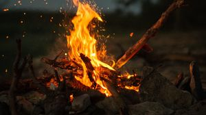 Preview wallpaper bonfire, fire, sticks, stones, camping