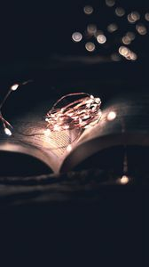 Preview wallpaper book, garland, light, darkness, reading