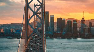 Preview wallpaper bridge, traffic, motion, sunset, city, san francisco, united states