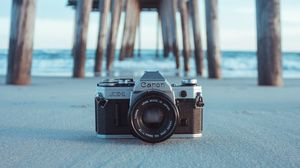 Preview wallpaper camera, pier, sand, blur