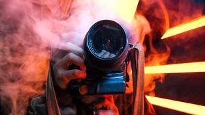 Preview wallpaper camera, smoke, photographer, lens, neon, light
