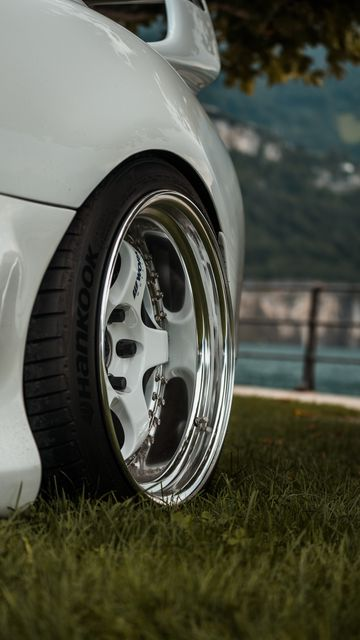 360x640 Wallpaper car, white, wheel, disk, closeup