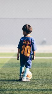 Preview wallpaper child, football player, football, football field, ball, lawn