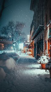 Preview wallpaper city, evening, snowfall, winter, street, buildings