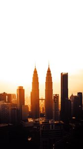 Preview wallpaper city, metropolis, sunset, towers