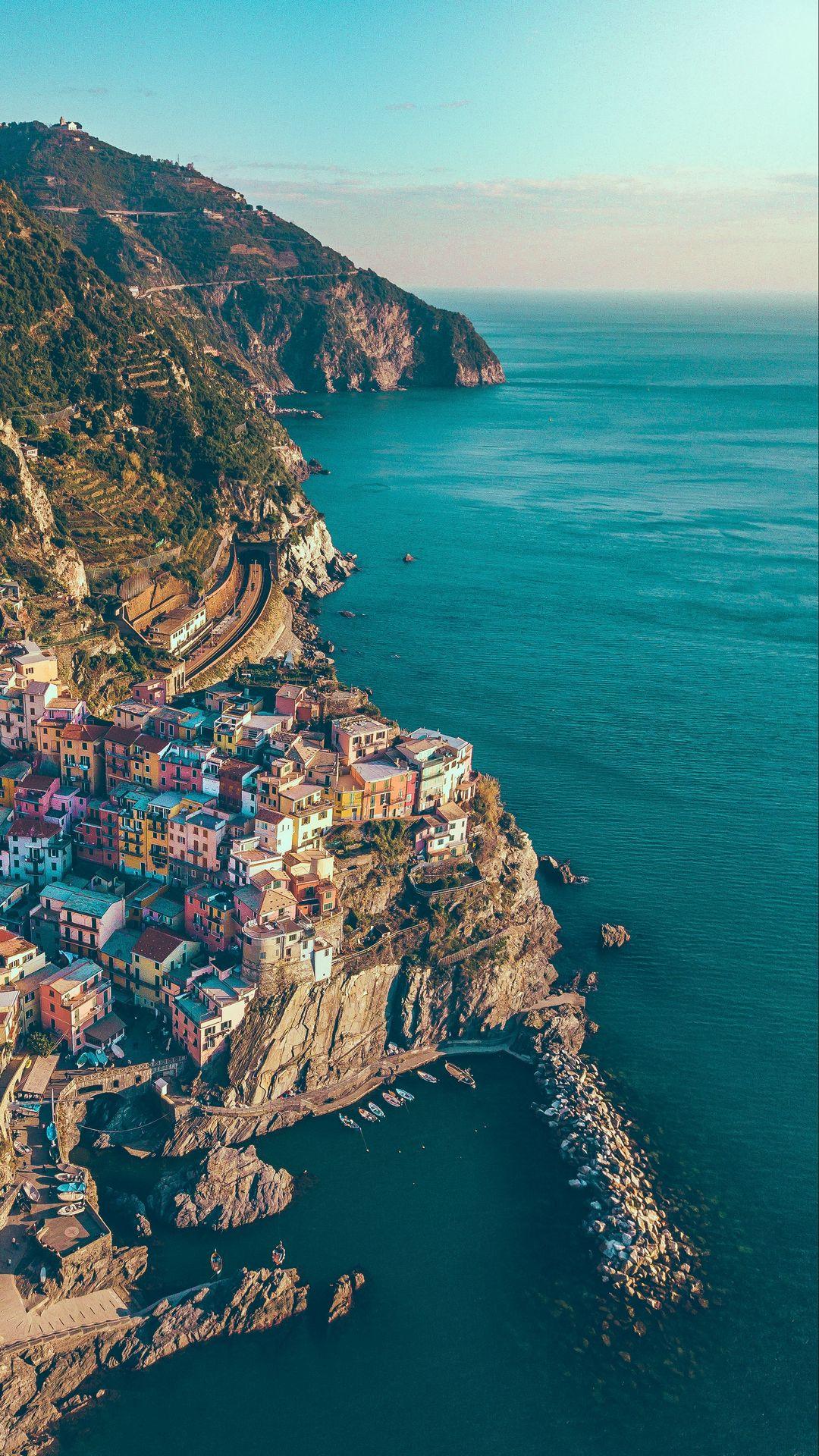 1080x1920 Wallpaper city, rocks, mountains, sea, manarola, italy