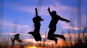 Preview wallpaper couple, jump, shadow, silhouette, grass, night