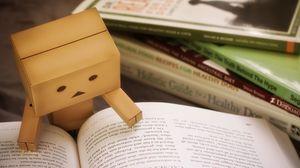 Preview wallpaper danbo, cardboard robot, book, reading