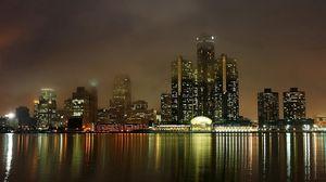 Preview wallpaper detroit, michigan, usa, america, night, view, lights, skyscrapers, houses, buildings, embankment, mist, reflection, water, metropolis, landscape, bay, sea, ocean
