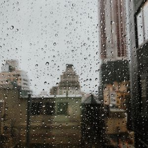 Preview wallpaper drops, rain, window, city, glass
