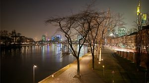Preview wallpaper evening, frankfurt, channel, strait, water, boat, pier, lights, bridge, park, trees, railroad tracks, houses, buildings, skyscrapers, wall, distance, road