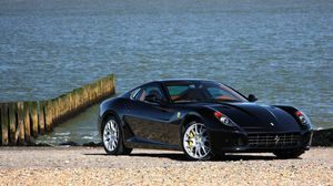 Preview wallpaper ferrari, black, front view, beach