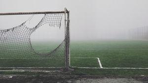 Preview wallpaper football gate, torn, fog, lawn, mood, gloomy