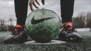 Preview wallpaper footballball, ball, football, football player, lawn