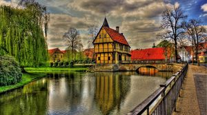 Preview wallpaper germany, architecture, beauty, bridge, clouds, colorful, colors, grass, green, home, house, reflection, river, road, sky, town, trees, view, water, hdr