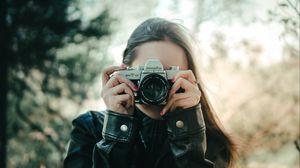 Preview wallpaper girl, camera, lens, photographer, photo