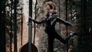 Preview wallpaper girl, musical instrument, forest