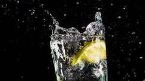Preview wallpaper glass, lemon, spray, drops, liquid, water