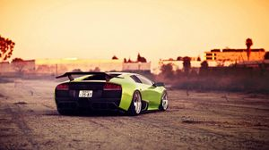 Preview wallpaper green, bright, city, lamborghini