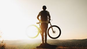 Preview wallpaper guy, bike, sun, mountains, active