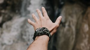 Preview wallpaper hand, fingers, wrist watches, waterfall