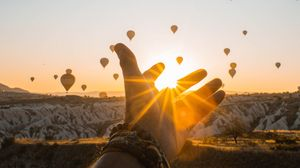 Preview wallpaper hand, sun, air balloons, mountains, sunrise