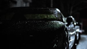 Preview wallpaper headlight, car, rain, darkness, front view
