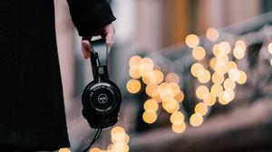 Preview wallpaper headphones, hand, coat, glare