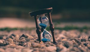Preview wallpaper hourglass, stones, blur