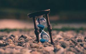 Preview wallpaper hourglass, stones, blur