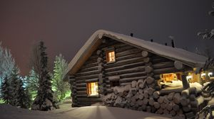 Preview wallpaper house, light, windows, winter, snowdrifts, logs