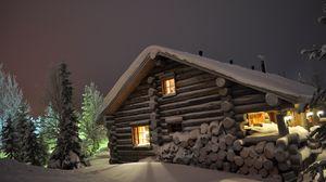 Preview wallpaper house, light, windows, winter, snowdrifts, logs