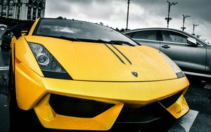 Preview wallpaper lamborghini, yellow, rain, street
