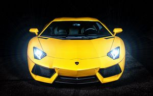 Preview wallpaper lamborghini, yellow, sports car, headlight, front view
