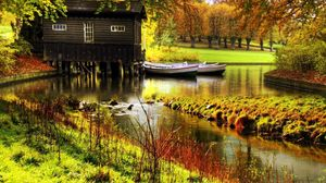 Preview wallpaper lodge, river, boats, pier, wood, garden, rods, colors