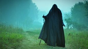 Preview wallpaper man, field, cloak, pilgrim, black, scary