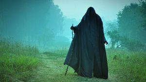 Preview wallpaper man, field, cloak, pilgrim, black, scary