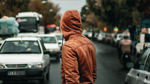 Preview wallpaper man, hood, road, street, cars