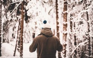 Preview wallpaper man, jacket, winter, forest