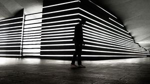 Preview wallpaper man, silhouette, alone, light, architecture, bw