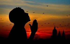 Preview wallpaper man, silhouette, prayer, sky